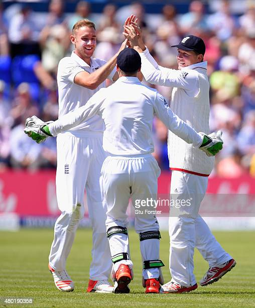 England bowler Stuart Broad celebrates with wicketkeeper Jos Buttler and catcher Gary Ballance after dismissing Mitchell Johnson during day three of...
