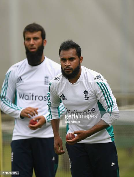 England bowlers Adil Rashid in action as Moeen Ali looks on during England Nets ahead of the 2nd Investec test match against Pakistan at Old Trafford...