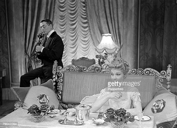 England British actor Laurence Olivier in his role as Grand Duke Charles speaking on the telephone with Elaine Dagenham played by Vivien Leigh in a...