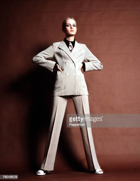 England British model Twiggy is pictured in a cream trouser suit
