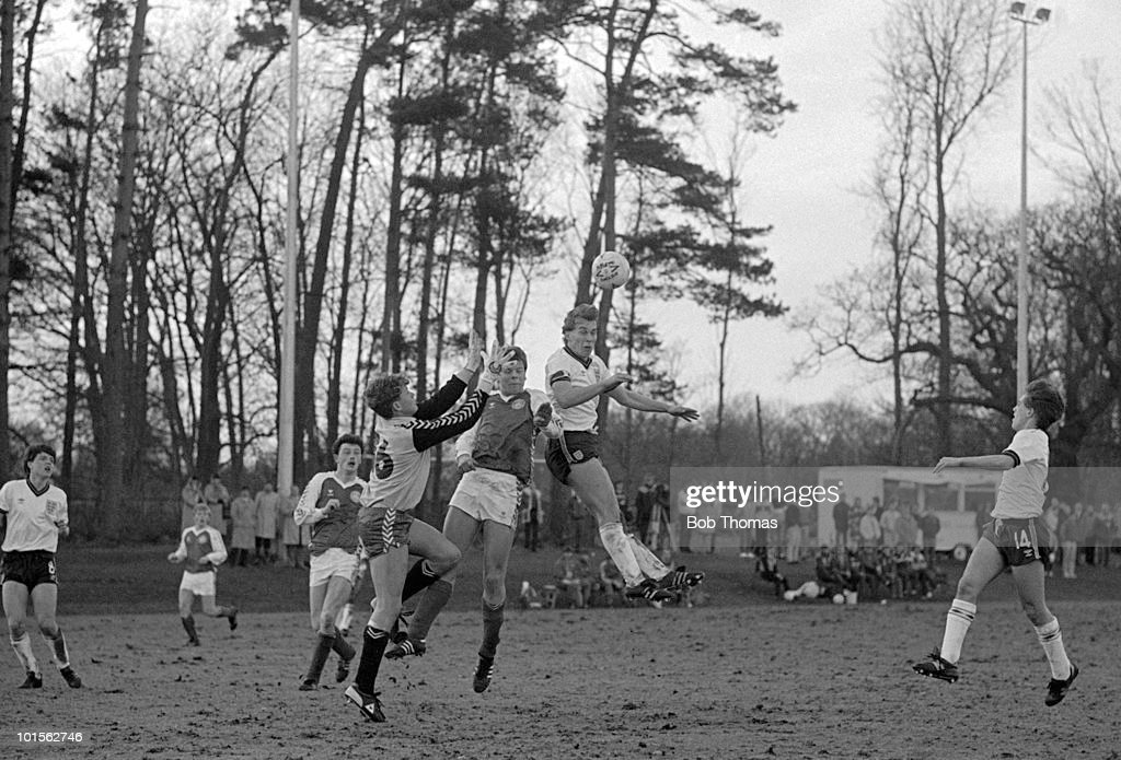 England captain Adam King outjumps the Denmark defence to score the second goal during their Under-16 International match held at the Football Association GM School in Lilleshall on 8th August 1986. England Under-16s beat Denmark Under-16s 3-0. (Bob Thomas/Getty Images).