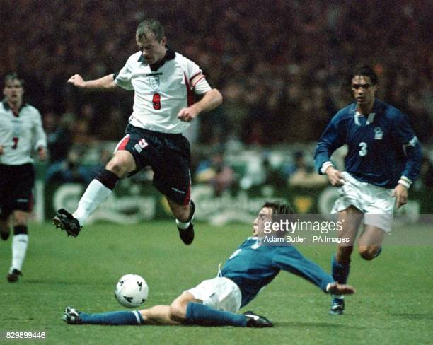 England captain Alan Shearer avoids a tackle by Italy's Fabio Cannavaro during tonight's World Cup qualifier at Wembley Photo by Adam Butler/PA