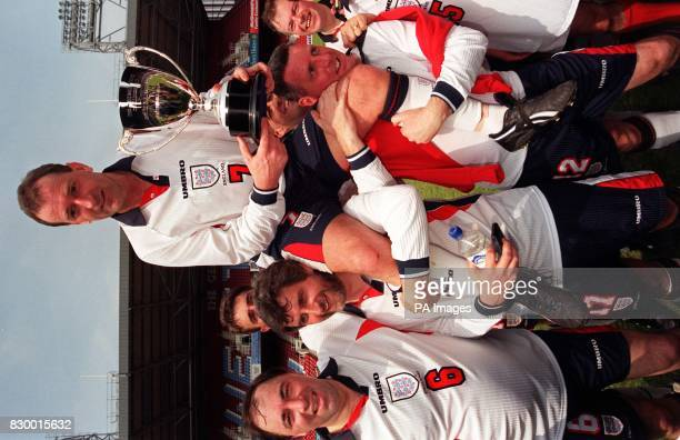 England captain Alan Simpson Labour MP for Nottingham South sits on the shoulders of his teammates as he holds aloft the charity Football Trust...