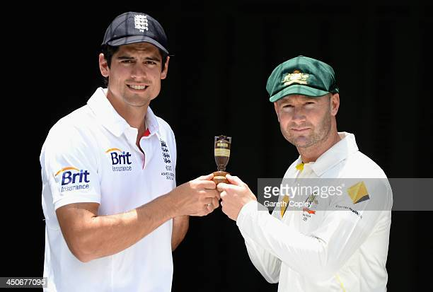England captain Alastair Cook and Australia captain Michael Clarke hold a replica ashes urn during an Ashes captain's photocall at The Gabba on...