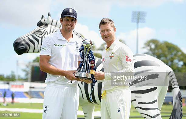 England captain Alastair Cook and Australian captain Michael Clarke poses with the Investec trophy ahead of the 1st Investec Ashes Test match between...