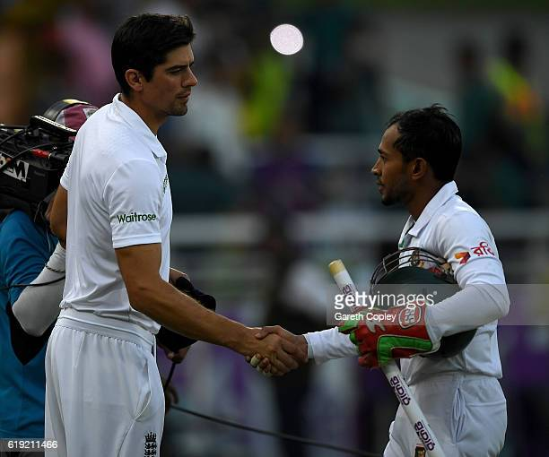 England captain Alastair Cook and Bangladesh captain Mushfiqur Rahim shake hands after day three of the second Test match between Bangladesh and...