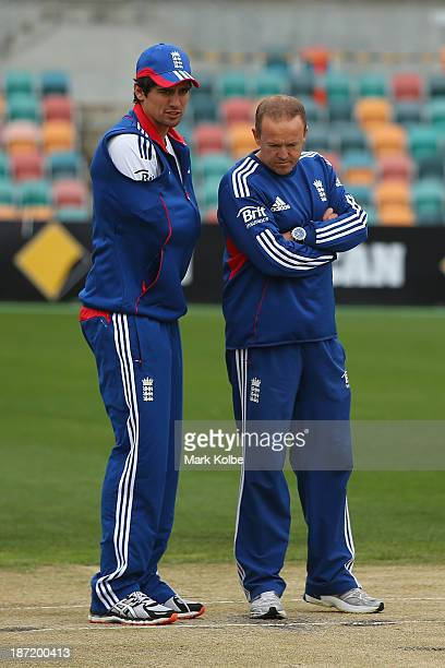 England captain Alastair Cook and England coach Andy Flower inspect the pitch before play is abandoned for the day during day two of the tour match...