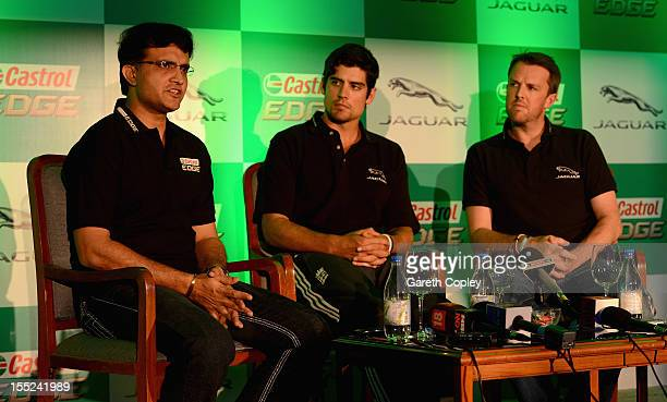 England captain Alastair Cook and Graeme Swann listen to former Indian cricketer Sourav Ganguly during a press conference to promote Jaguar and...