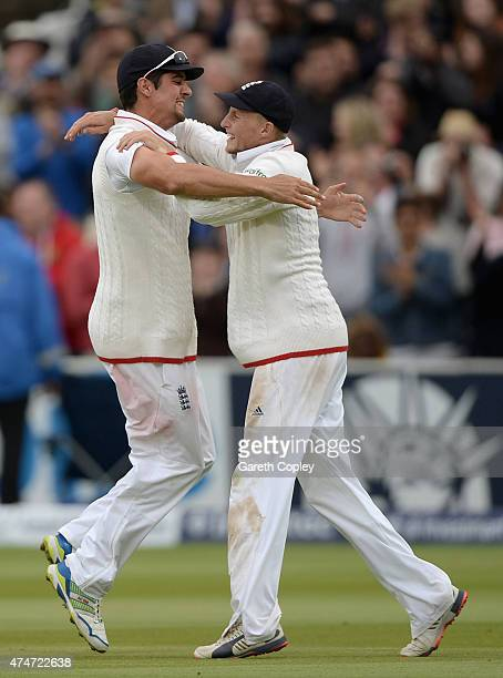 England captain Alastair Cook and Joe Root celebrate after winning the 1st Investec Test match between England and New Zealand at Lord's Cricket...