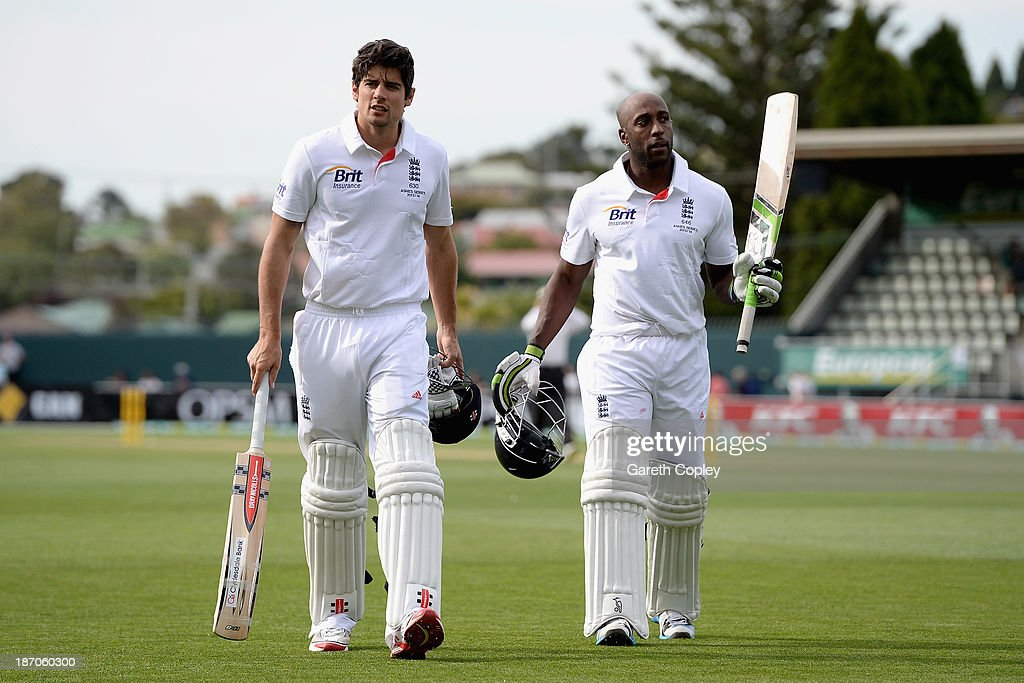 England captain <a gi-track='captionPersonalityLinkClicked' href=/galleries/search?phrase=Alastair+Cook+-+Cricket+Player&family=editorial&specificpeople=571475 ng-click='$event.stopPropagation()'>Alastair Cook</a> and <a gi-track='captionPersonalityLinkClicked' href=/galleries/search?phrase=Michael+Carberry&family=editorial&specificpeople=600686 ng-click='$event.stopPropagation()'>Michael Carberry</a> salute the crowd as they leave the field at the end of day one of the tour match between Australia A and England at Blundstone Arena on November 6, 2013 in Hobart, Australia.
