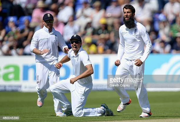 England captain Alastair Cook and Moeen Ali celebrate dismissing Steven Smith of Australia during day two of the 1st Investec Ashes Test match...