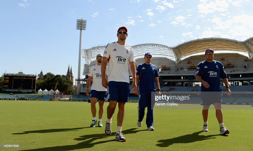 England captain <a gi-track='captionPersonalityLinkClicked' href=/galleries/search?phrase=Alastair+Cook+-+Cricket+Player&family=editorial&specificpeople=571475 ng-click='$event.stopPropagation()'>Alastair Cook</a> arrives alongside <a gi-track='captionPersonalityLinkClicked' href=/galleries/search?phrase=Matt+Prior+-+Cricket+Player&family=editorial&specificpeople=13652111 ng-click='$event.stopPropagation()'>Matt Prior</a>, coach Andy Flower and bowling coach David Saker for a nets session at Adelaide Oval on December 2, 2013 in Adelaide, Australia.