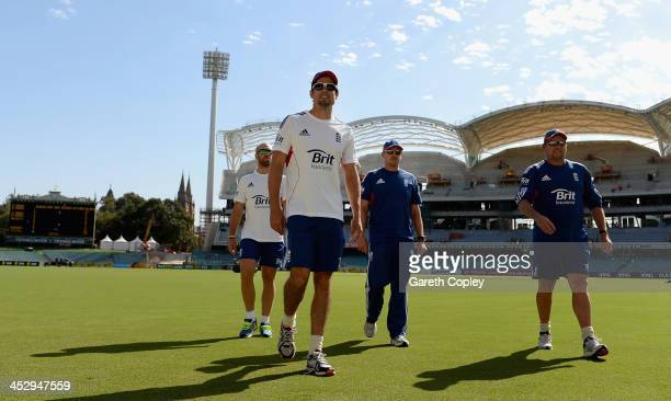 England captain Alastair Cook arrives alongside Matt Prior coach Andy Flower and bowling coach David Saker for a nets session at Adelaide Oval on...