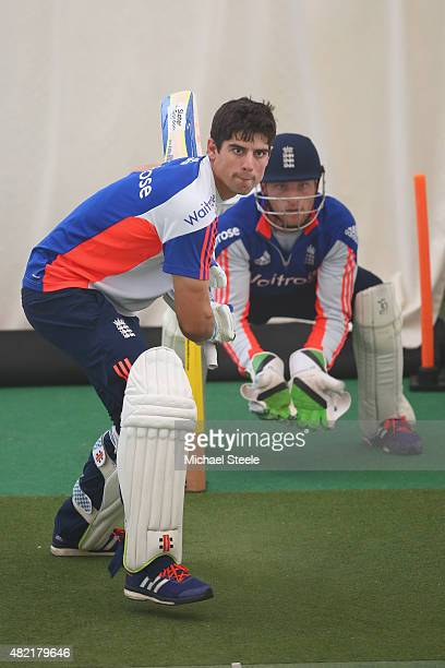 England captain Alastair Cook bats as wicketkeeper Jos Buttler looks on during the England indoor nets session ahead of the 3rd Investec Ashes Test...