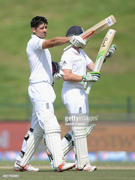 England captain Alastair Cook celebrates reaching his century during day three of the 1st Test between Pakistan and England at Zayed Cricket Stadium...