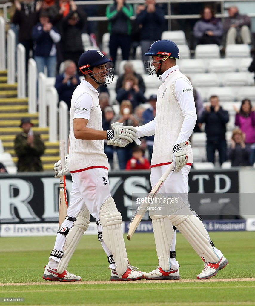 England captain Alastair Cook (L) celebrates with Alex Hailes after hitting a boundry to take him to ten thousand test runs during day four of the 2nd Investec Test match between England and Sri Lanka at Emirates Durham ICG on May 30, 2016 in Chester-le-Street, United Kingdom.
