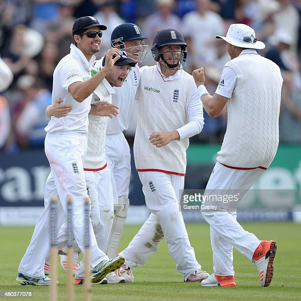 England captain Alastair Cook celebrates with teammates Adam Lyth Jos Buttler and Gary Ballance after winning the 1st Investec Ashes Test match...