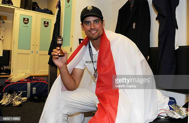 England captain Alastair Cook celebrates with the ashes urn in the dressing rooms after the 5th Investec Ashes Test match between England and...