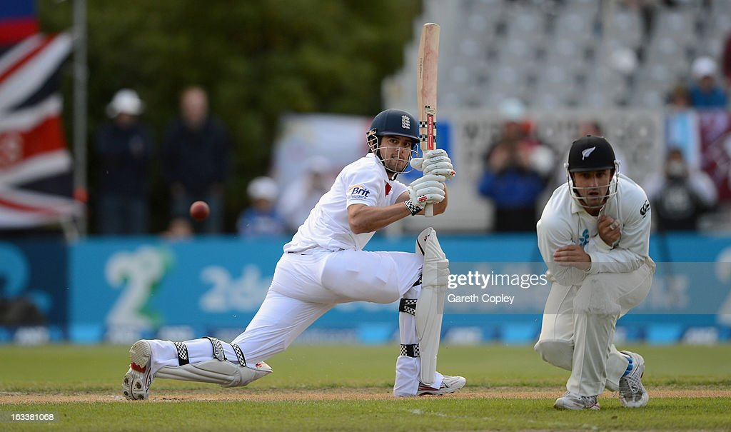 England captain Alastair Cook hits past New Zealand fielder Hamish Rutherford during day four of the First Test match between New Zealand and England...