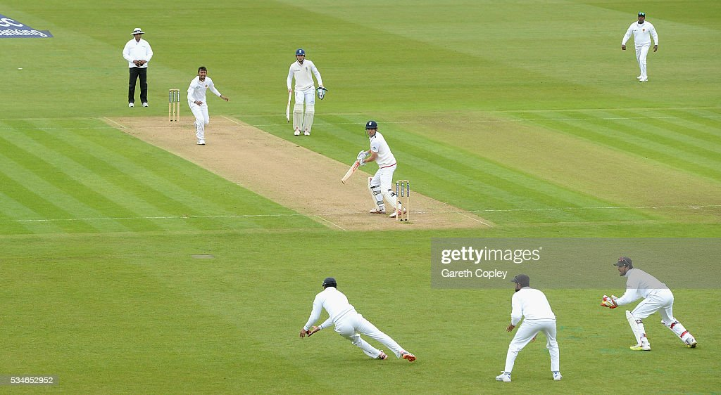 England captain <a gi-track='captionPersonalityLinkClicked' href=/galleries/search?phrase=Alastair+Cook+-+Cricket+Player&family=editorial&specificpeople=571475 ng-click='$event.stopPropagation()'>Alastair Cook</a> is caught out by <a gi-track='captionPersonalityLinkClicked' href=/galleries/search?phrase=Dimuth+Karunaratne&family=editorial&specificpeople=7915648 ng-click='$event.stopPropagation()'>Dimuth Karunaratne</a> of Sri Lanka during day one of the 2nd Investec Test match between England and Sri Lanka at Emirates Durham ICG on May 27, 2016 in Chester-le-Street, United Kingdom.