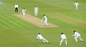 England captain Alastair Cook is caught out by Dimuth Karunaratne of Sri Lanka during day one of the 2nd Investec Test match between England and Sri...