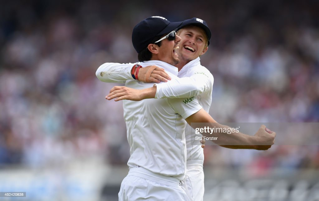 England captain <a gi-track='captionPersonalityLinkClicked' href=/galleries/search?phrase=Alastair+Cook+-+Cricket+Player&family=editorial&specificpeople=571475 ng-click='$event.stopPropagation()'>Alastair Cook</a> is congratulated by <a gi-track='captionPersonalityLinkClicked' href=/galleries/search?phrase=Joe+Root&family=editorial&specificpeople=6688996 ng-click='$event.stopPropagation()'>Joe Root</a> (r) after taking a catch to dismiss India batsman Stuart Binny during day four of 2nd Investec Test match between England and India at Lord's Cricket Ground on July 20, 2014 in London, United Kingdom.