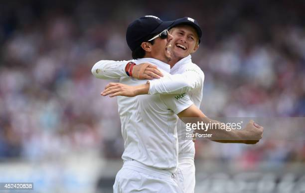 England captain Alastair Cook is congratulated by Joe Root after taking a catch to dismiss India batsman Stuart Binny during day four of 2nd Investec...