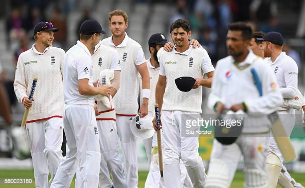 England captain Alastair Cook is congratulated by team mates after the last wicket of Pakistan batsman Mohammad Amir had been taken to win the match...