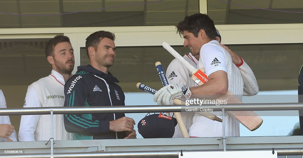 England captain <a gi-track='captionPersonalityLinkClicked' href=/galleries/search?phrase=Alastair+Cook+-+Cricketspeler&family=editorial&specificpeople=571475 ng-click='$event.stopPropagation()'>Alastair Cook</a> is congratuted by teammates James Anderson and Joe Root after reaching 10,000 test runs and winning the 2nd Investec Test match between England and Sri Lanka at Emirates Durham ICG on May 30, 2016 in Chester-le-Street, United Kingdom.