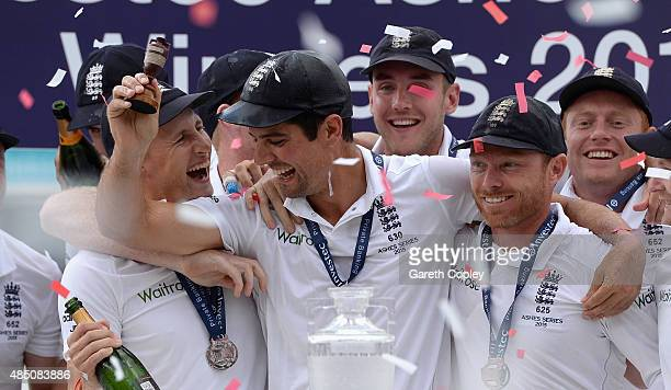 England captain Alastair Cook Joe Root and Ian Bell celebrate with the ashes urn after the 5th Investec Ashes Test match between England and...