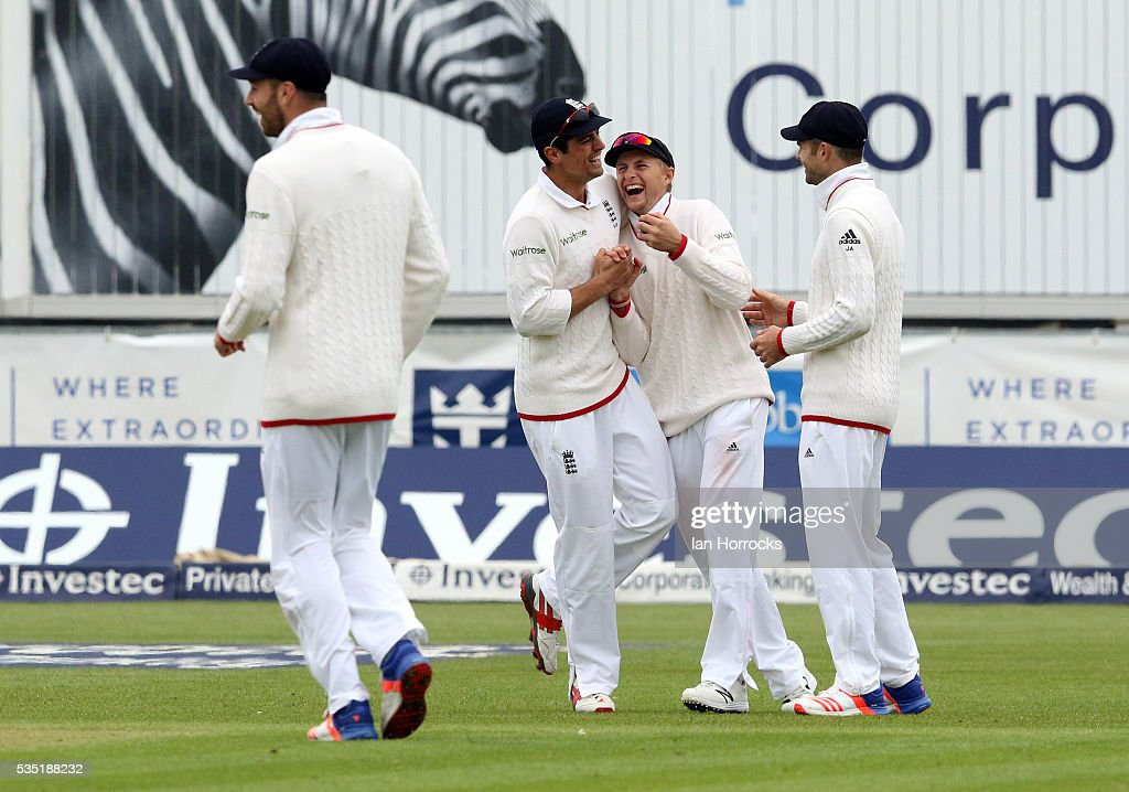 England captain Alastair Cook laughs with Joe Root (C) after the wicket of Dimuth Karunaratne was caught by Root during day three of the 2nd Investec Test match between England and Sri Lanka at Emirates Durham ICG on May 29, 2016 in Chester-le-Street, United Kingdom.