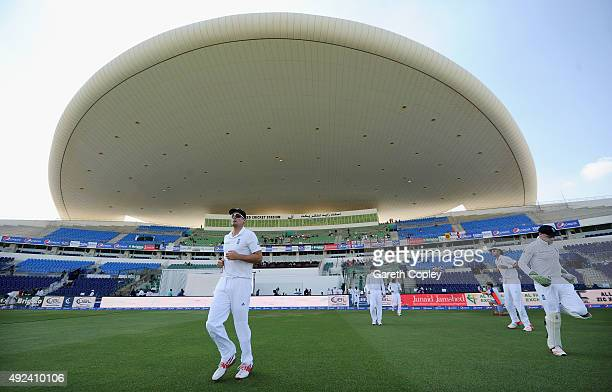 England captain Alastair Cook leads his team out ahead of the 1st Test between Pakistan and England at Zayed Cricket Stadium on October 13 2015 in...