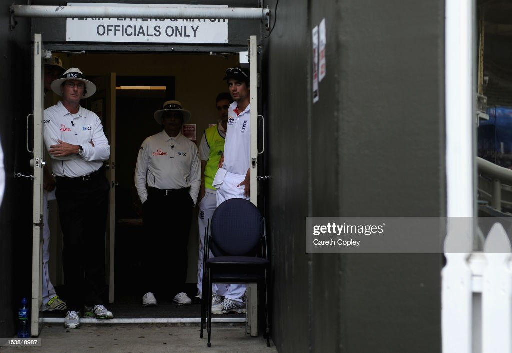 England captain <a gi-track='captionPersonalityLinkClicked' href=/galleries/search?phrase=Alastair+Cook+-+Cricket+Player&family=editorial&specificpeople=571475 ng-click='$event.stopPropagation()'>Alastair Cook</a> looks from the dressing room during a rain break during day four of the second Test match between New Zealand and England at Basin Reserve on March 17, 2013 in Wellington, New Zealand.