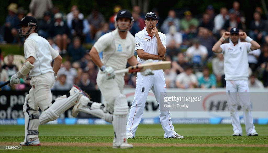 England captain <a gi-track='captionPersonalityLinkClicked' href=/galleries/search?phrase=Alastair+Cook+-+Cricket+Player&family=editorial&specificpeople=571475 ng-click='$event.stopPropagation()'>Alastair Cook</a> looks on as Hamish Rutheford and Kane Williamson of New Zealand score runs during day three of the First Test match between New Zealand and England at University Oval on March 8, 2013 in Dunedin, New Zealand.