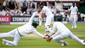 England captain Alastair Cook plays the ball between Azhar Ali and Younis Khan of Pakistan during day two of the 1st Investec Test between England...