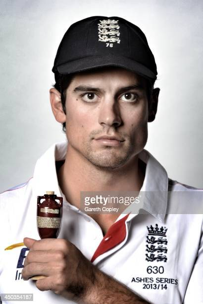 England Captain Alastair Cook poses with a replica urn ahead of the First Ashes Test on November 11 2013 in Sydney Australia