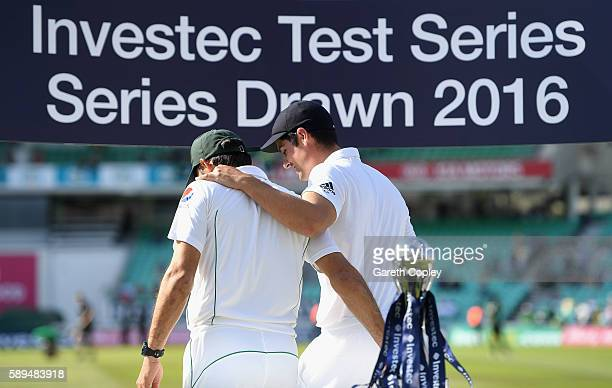 England captain Alastair Cook puts his arm round Pakistan captain MisbahulHaq after sharing the series trophy between England and Pakistan at The Kia...