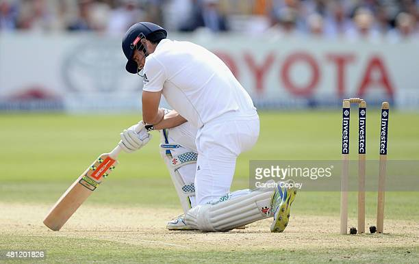 England captain Alastair Cook reacts after being bowled by Mitchell Marsh of Australia during day three of the 2nd Investec Ashes Test match between...