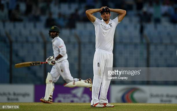 England captain Alastair Cook reacts as Sabbir Rahman of Bangladesh scores runs during the 4th day of the 1st Test match between Bangladesh and...