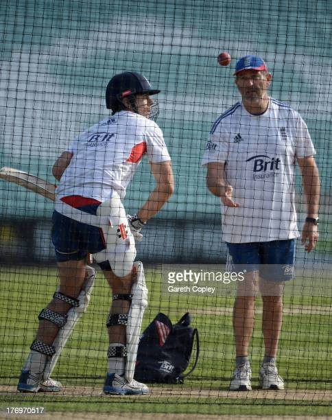 England captain Alastair Cook receives throwdowns from batting coach Graham Gooch during nets session at The Kia Oval on August 20 2013 in London...
