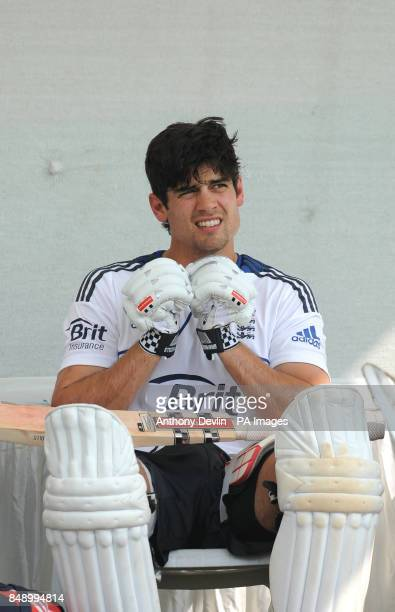 England captain Alastair Cook relaxes following a nets practice session at the Sardar Patel Stadium Ahmedabad India