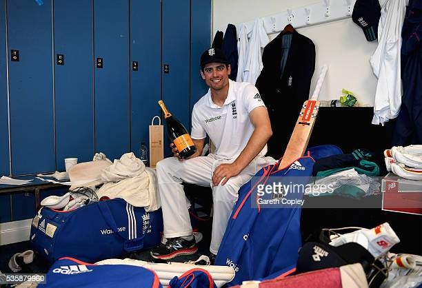 England captain Alastair Cook relaxes in the dressing room after reaching 10000 test runs and winning the 2nd Investec Test match between England and...