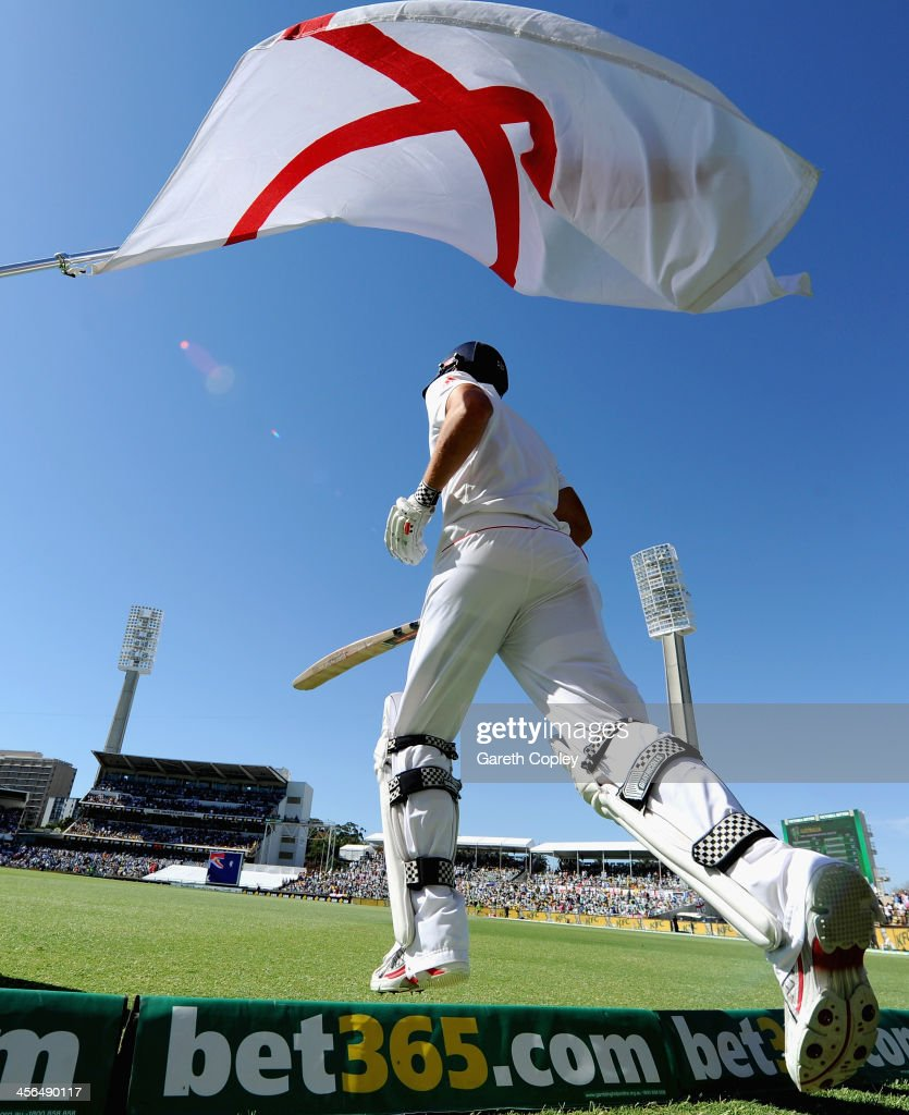 England captain <a gi-track='captionPersonalityLinkClicked' href=/galleries/search?phrase=Alastair+Cook+-+Cricket+Player&family=editorial&specificpeople=571475 ng-click='$event.stopPropagation()'>Alastair Cook</a> runs out to bat during day two of the Third Ashes Test Match between Australia and England at WACA on December 14, 2013 in Perth, Australia.