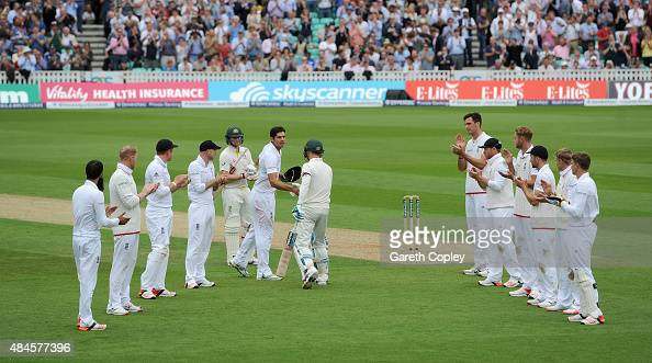 England captain Alastair Cook shakes hands with Australian captain Michael Clarke as he walks out to bat in his final test during day one of the 5th...