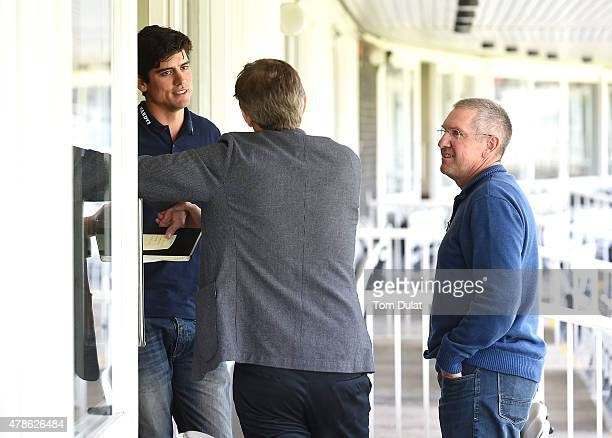 England Captain Alastair Cook speaks to team's new coach Trevor Bayliss during the England Cricket media access day at Lord's Cricket Ground on June...