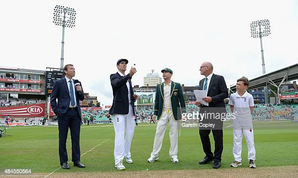 England captain Alastair Cook tosses the coin alongside Australian captain Michael Clarke ahead of day one of the 5th Investec Ashes Test match...