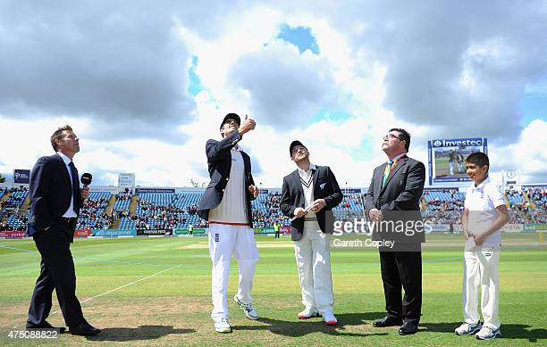 England captain Alastair Cook tosses the coin alongside Brendon McCullum of New Zealand ahead of day one of 2nd Investec Test match between England...