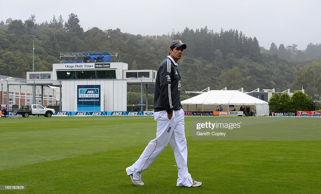 England captain <a gi-track='captionPersonalityLinkClicked' href=/galleries/search?phrase=Alastair+Cook+-+Cricket+Player&family=editorial&specificpeople=571475 ng-click='$event.stopPropagation()'>Alastair Cook</a> walks across the outfield as rain delays play during day one of the First Test match between New Zealand and England at University Oval on March 6, 2013 in Dunedin, New Zealand.