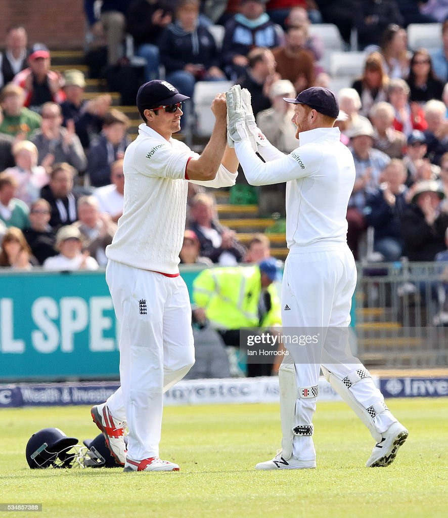 England captain Alistair Cook (L) celebrates taking the catch for the wicket ofDinesh Chandimal of Sri Lanka during day two of the 2nd Investec Test match between England and Sri Lanka at Emirates Durham ICG on May 28, 2016 in Chester-le-Street, United Kingdom.