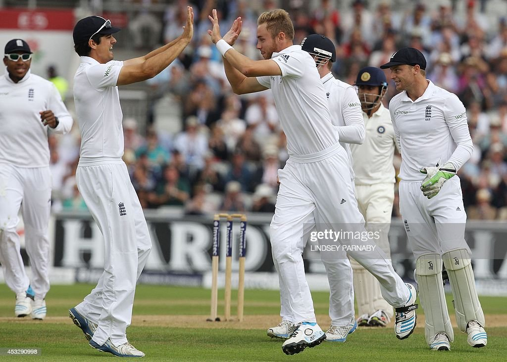 England captain Alistair Cook (2-L) congratulates teammate (3-L) after he took the wicket of India's batsman Gautam Gambhir during the first day of the fourth cricket Test match between England and India at Old Trafford in Manchester on August 7, 2014.